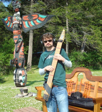 Tommy plays his Stick in front of the totem pole